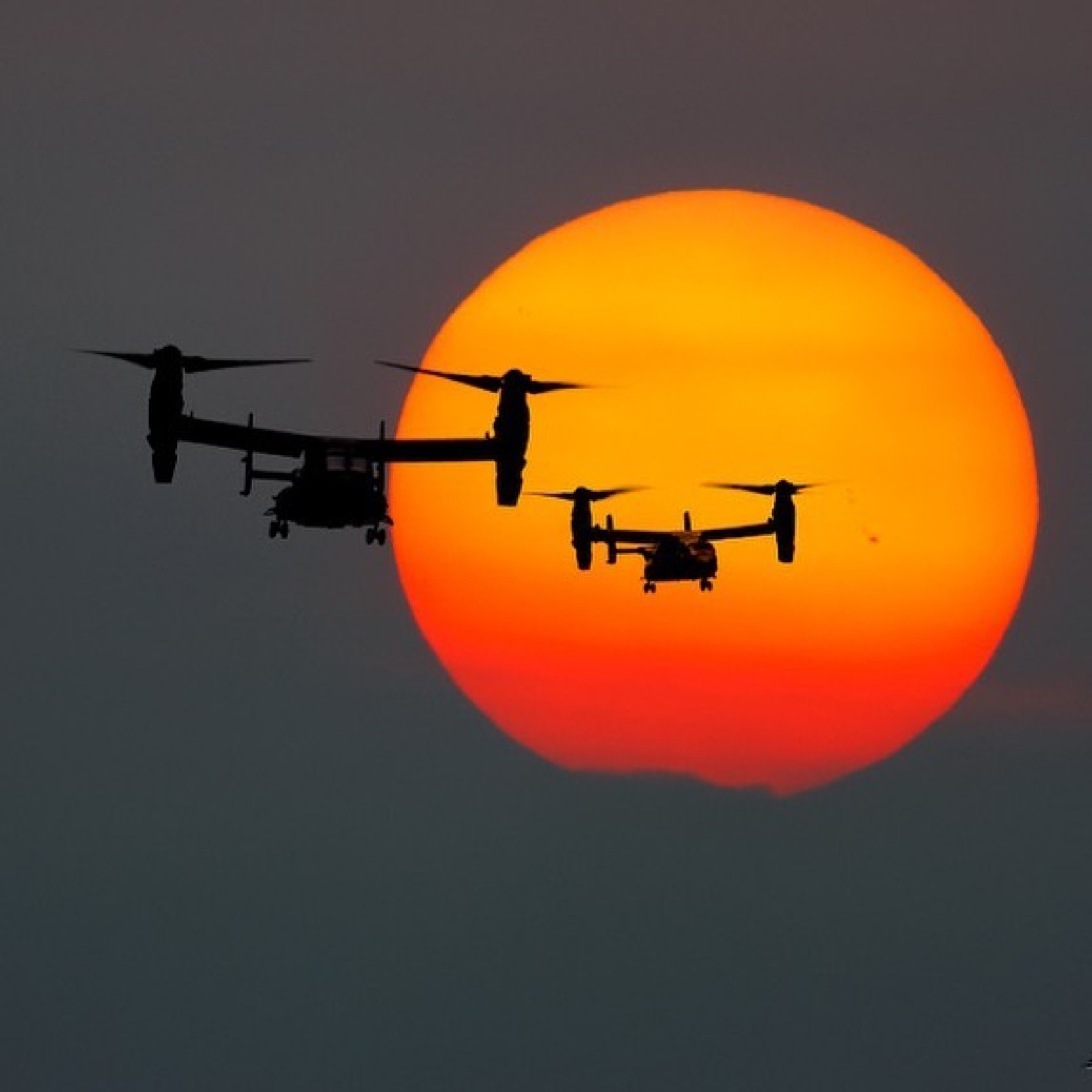 Two CV-22 Ospreys from Royal Air Force base Mildenhall fly at sunset. Photo shared by Nigel Blake