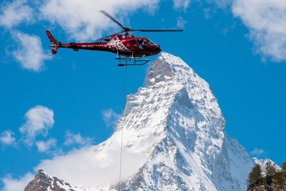 Air Zermatt Airbus AS350 long line operations with the impressive Matterhorn mountain in the background. Photo submitted by Matthias Hoeglauer
