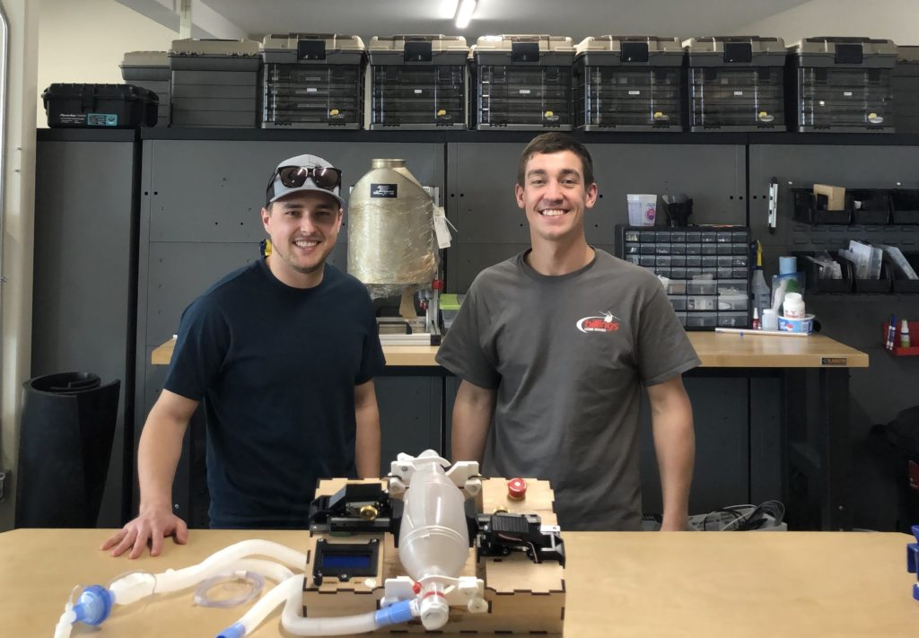 Billings Flying Service engineers Mikale Lynch and Tom Decker stand behind the company's prototype ventilator. Billings Flying Service Photo