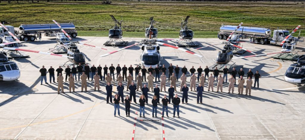 PJ Helicopters' staff stand in front of some of the company's fleet outside of its headquarters in Red Bluff, California. Seth Gunsauls Photo