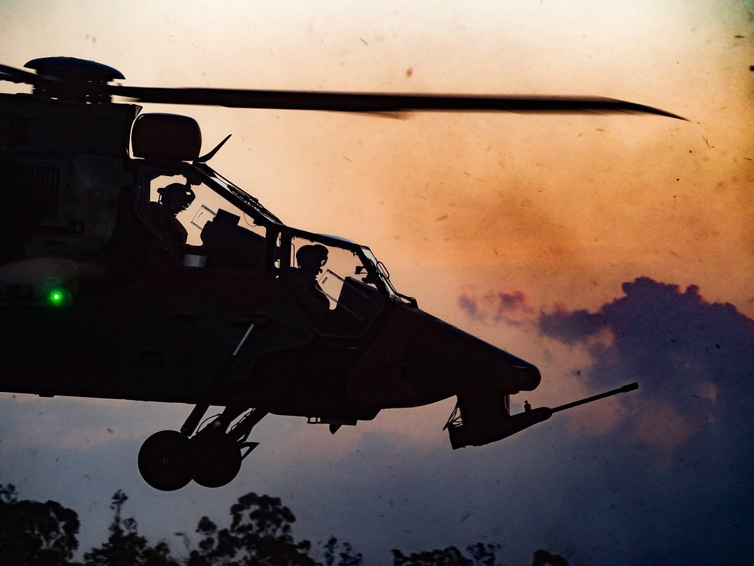 The silhouetted front end of an Australian Army Airbus Tiger. Photo submitted by Lloyd Greenfield (Instagram user @katipomedia) using #verticalmag
