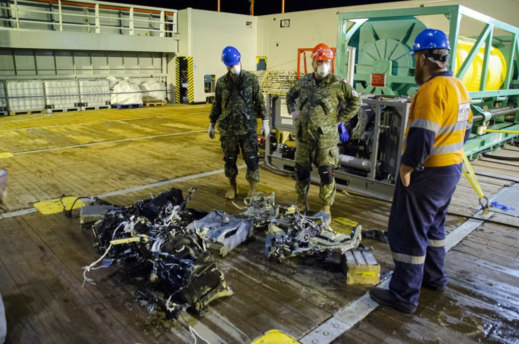 Canadian Armed Forces members and EDT Hercules personnel inspect recovered parts of Stalker 22 during recovery operations for the aircraft in the Mediterranean Sea on May 31, 2020. Cdr Robert Watt Photo