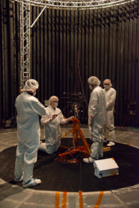 NASA engineers prepare the aircraft for a flight test in the space simulator at the Jet Propulsion Laboratory. The simulator can replicate many of the conditions found on Mars, such as its extremely thin atmosphere. NASA/JPL-Caltech Photo