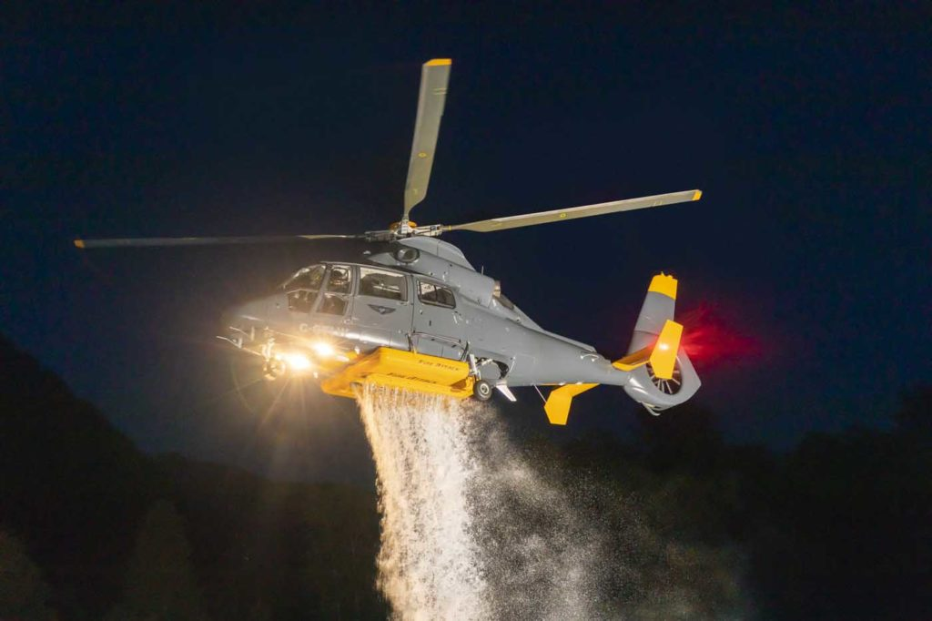 A Talon Helicopters Airbus AS365 N2 performs a water drop exercise near Pitt River, British Columbia. Heath Moffatt Photo