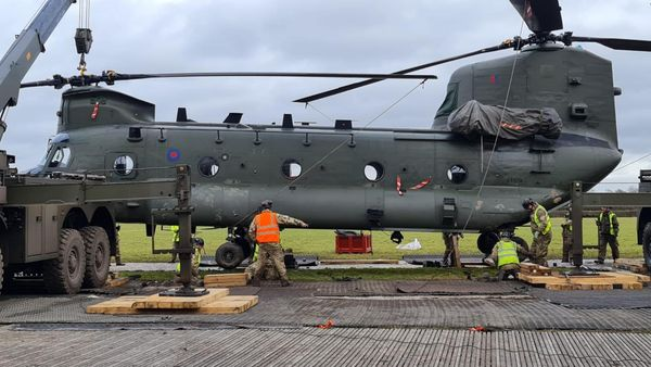 The RAF Benson-based Chinook is lifted from the mire by two cranes and placed on a prepared platform on Jan. 11. RAF Benson Photo