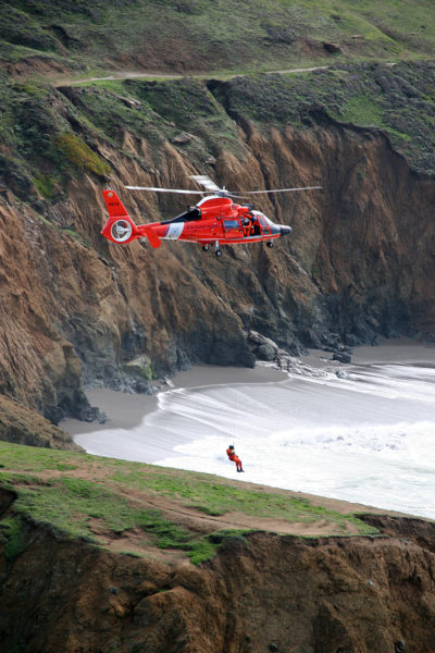 An Airbus HH-65C Dolphin from US Coast Guard Air Station San Francisco practices cliff operations off Mori Point. Matt Udkow Photo